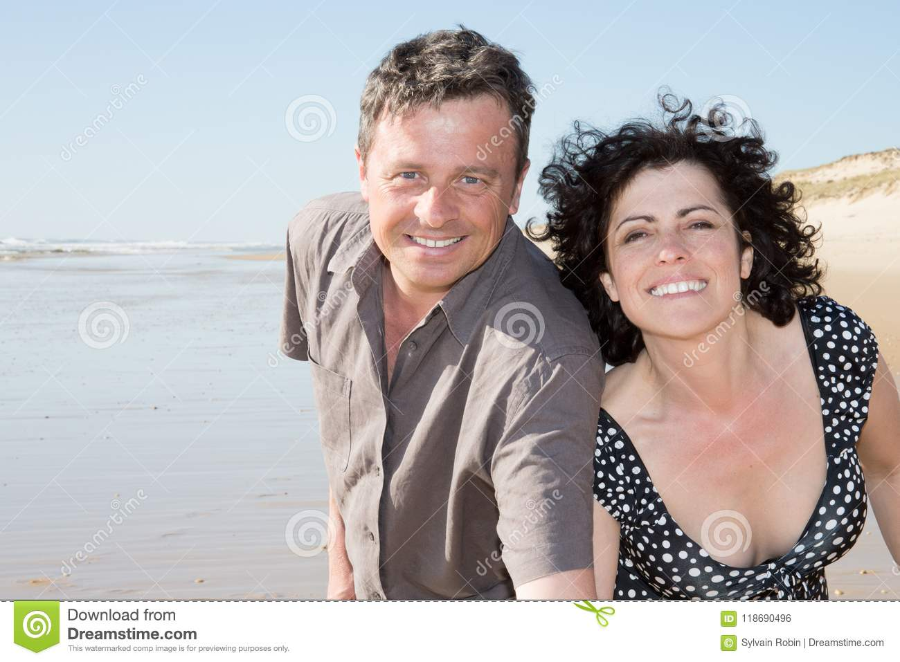 Romantic Middle Aged Couple Enjoying play and love on the Beach