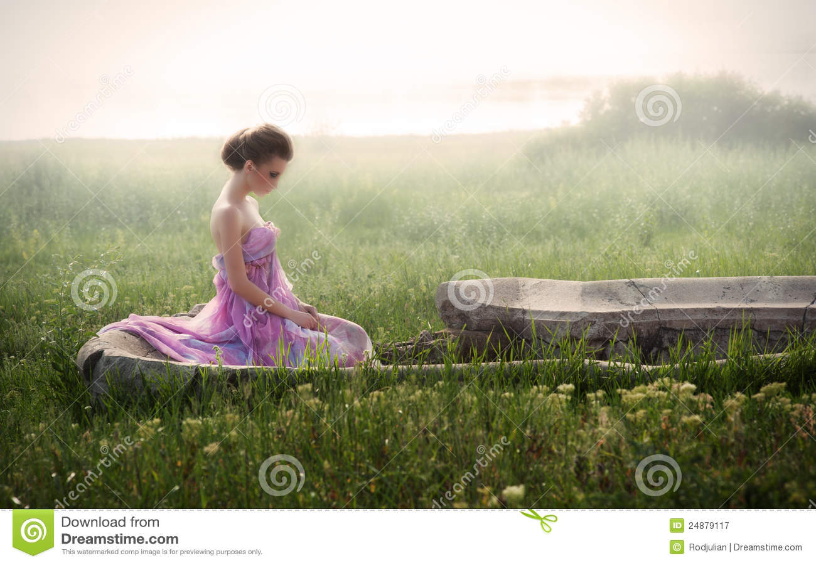 Romantic portrait of woman in ruins