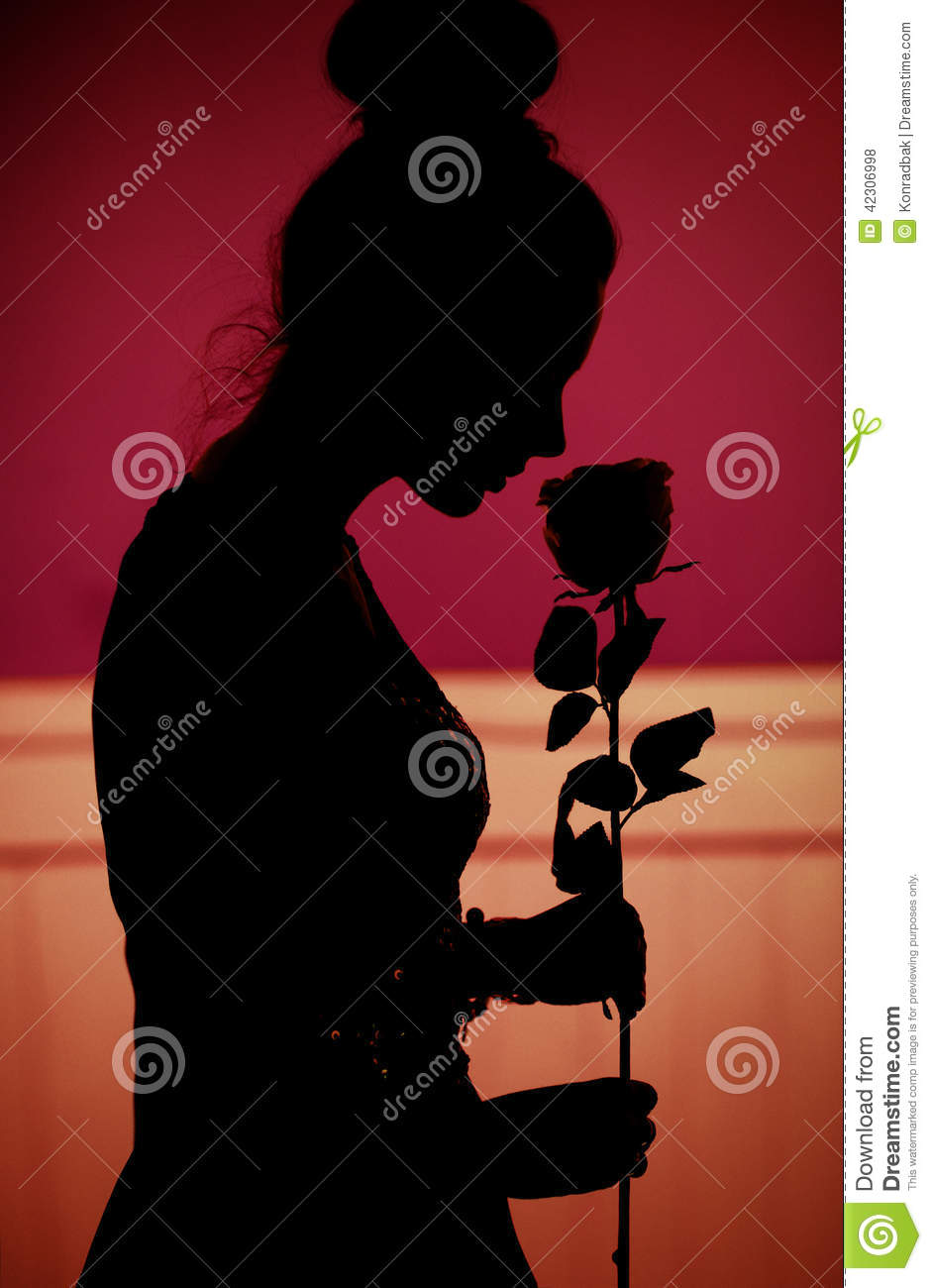 Romantic scene of the woman with rose given by husband