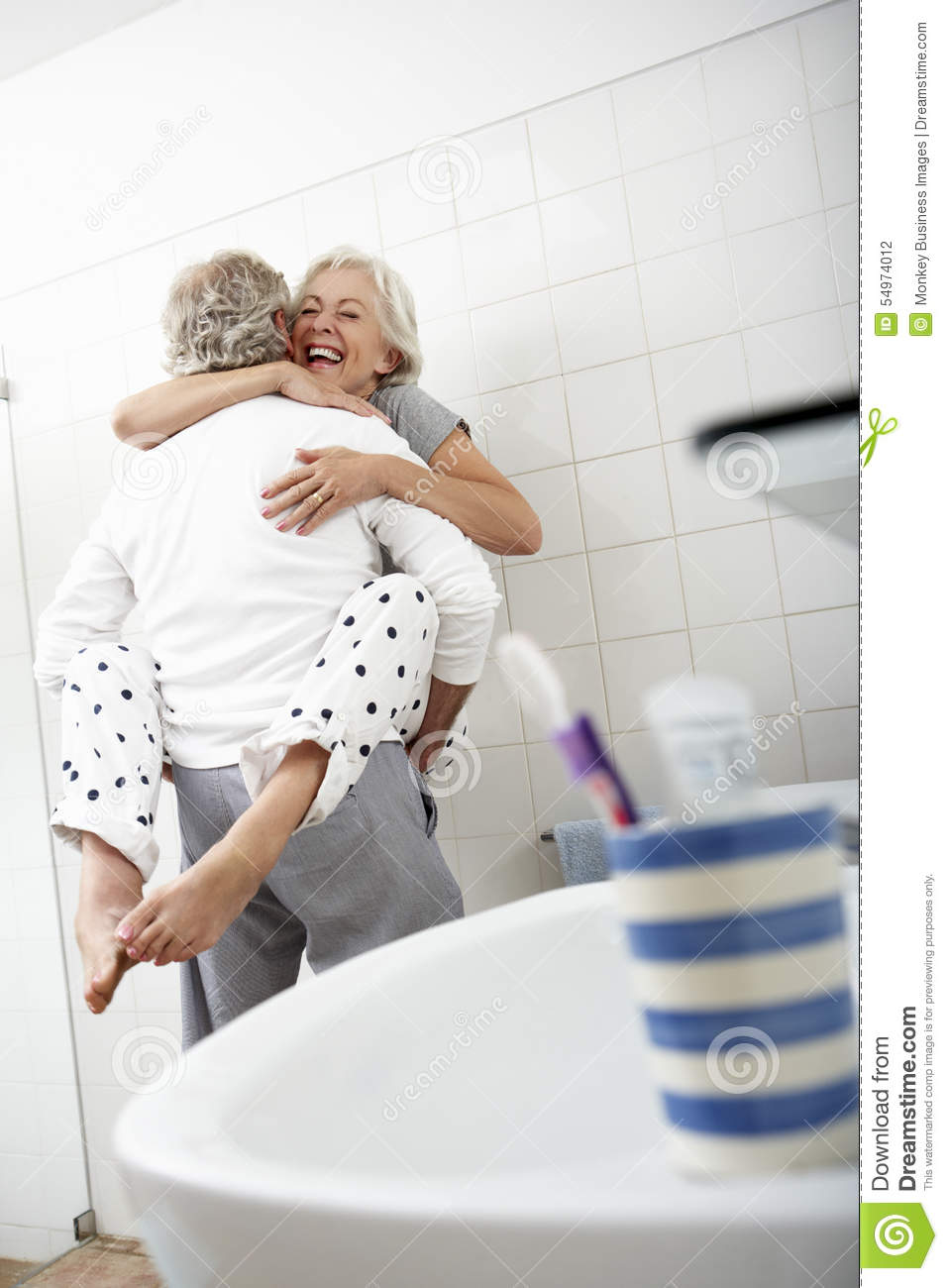 Romantic Senior Couple In Bathroom Romance Passion