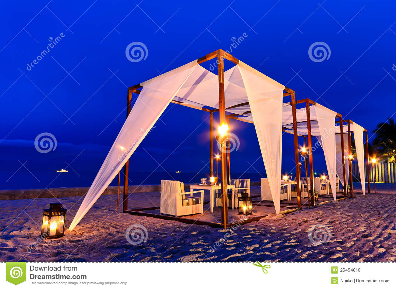 romantic dinner set up on the beach stock photo - image: 61303518