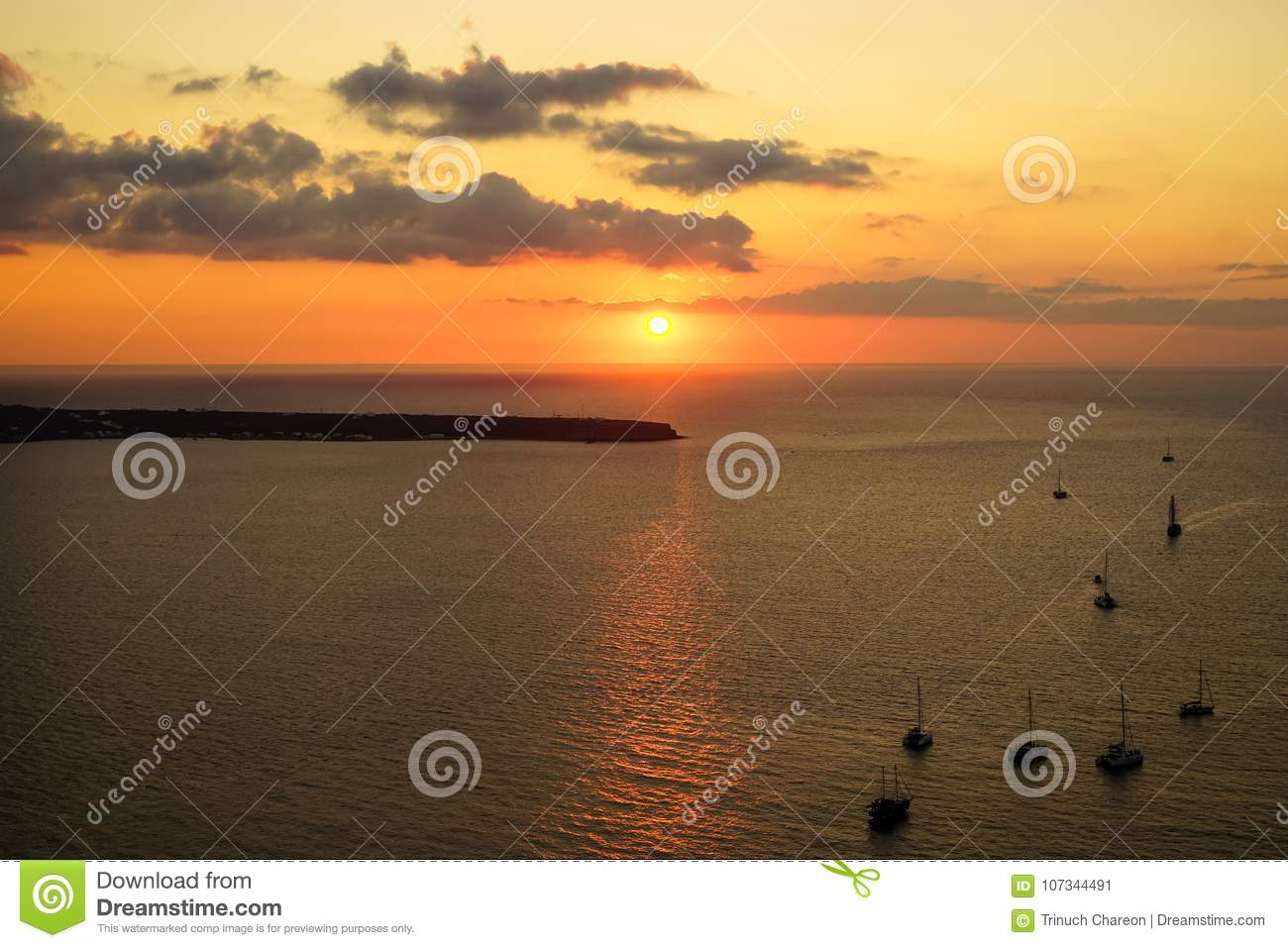 Romantic sunset scenic ocean view in vast Aegean sea with sailing ships silhouette, abstract cloud and light reflection