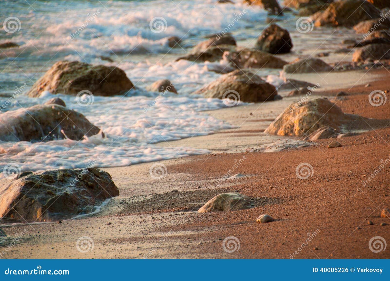 Romantic sunset at sea, waves