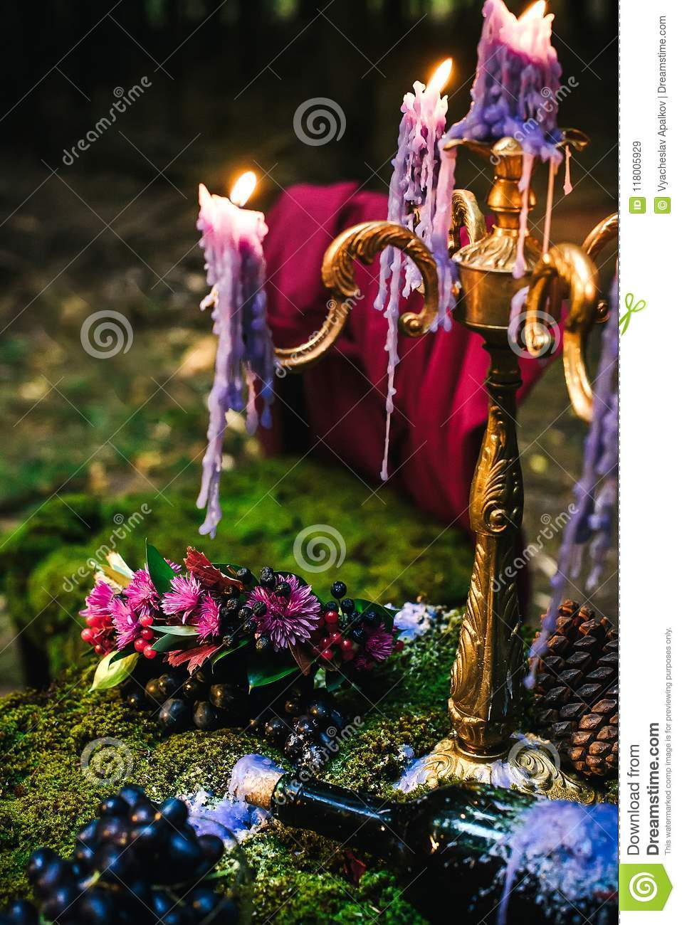 Romantic table with moss, candles dripping