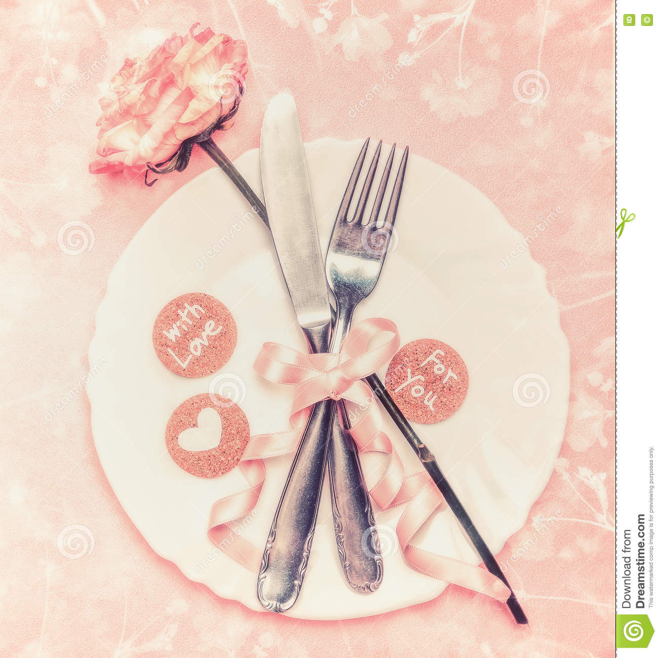 Table Setting Background romantic table setting with plate, rose flower, cutlery and ribbon