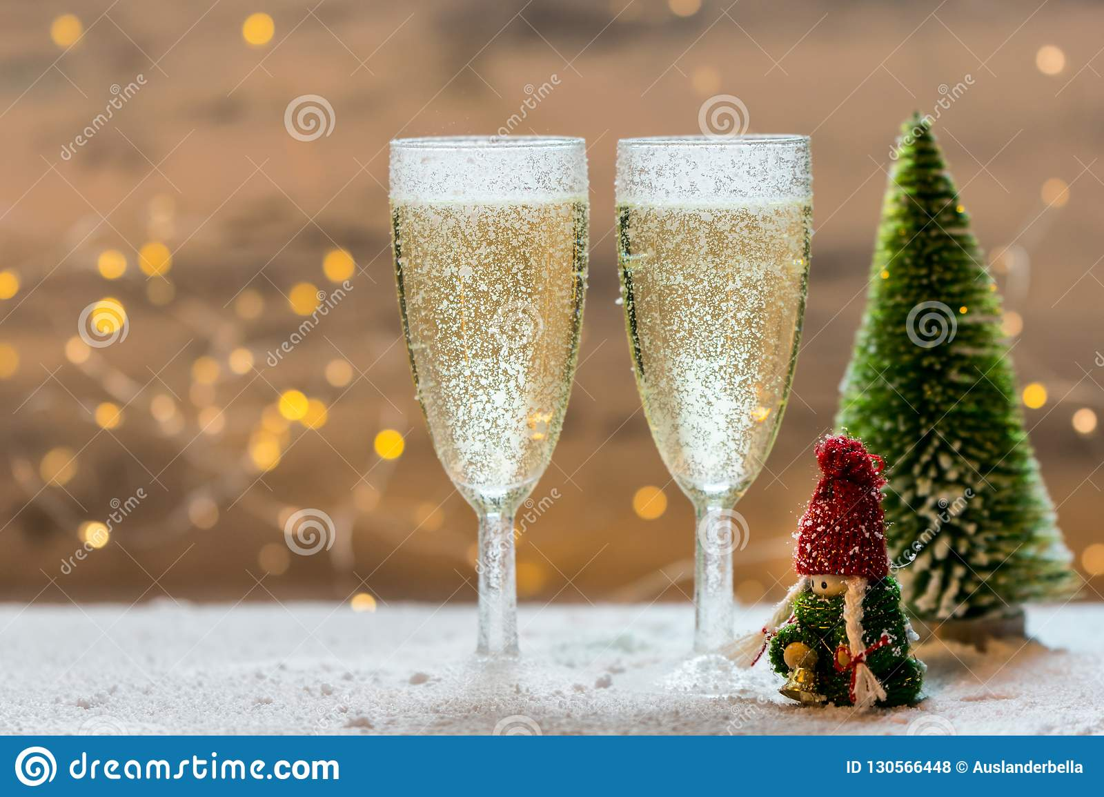 Romantic, white and golden winter background with two glasses of champagne