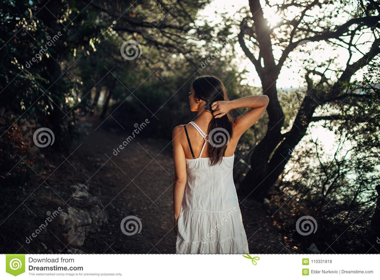 Romantic woman enjoying walk in the nature on a sunny morning.Mindful carefree female in natural environment feeling stress free