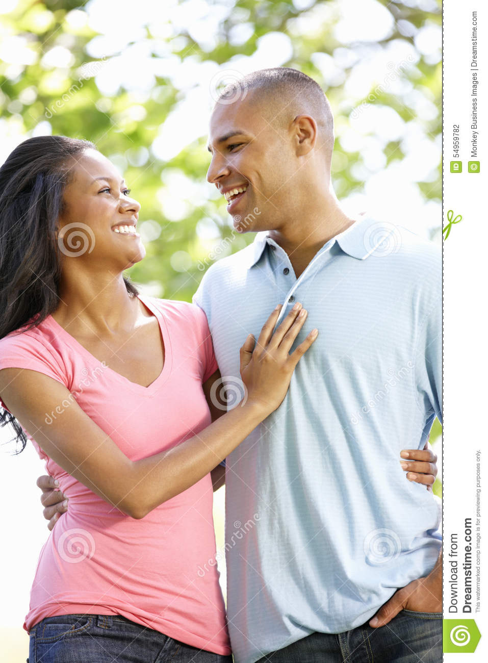 Romantic Young African American Couple Walking In Park