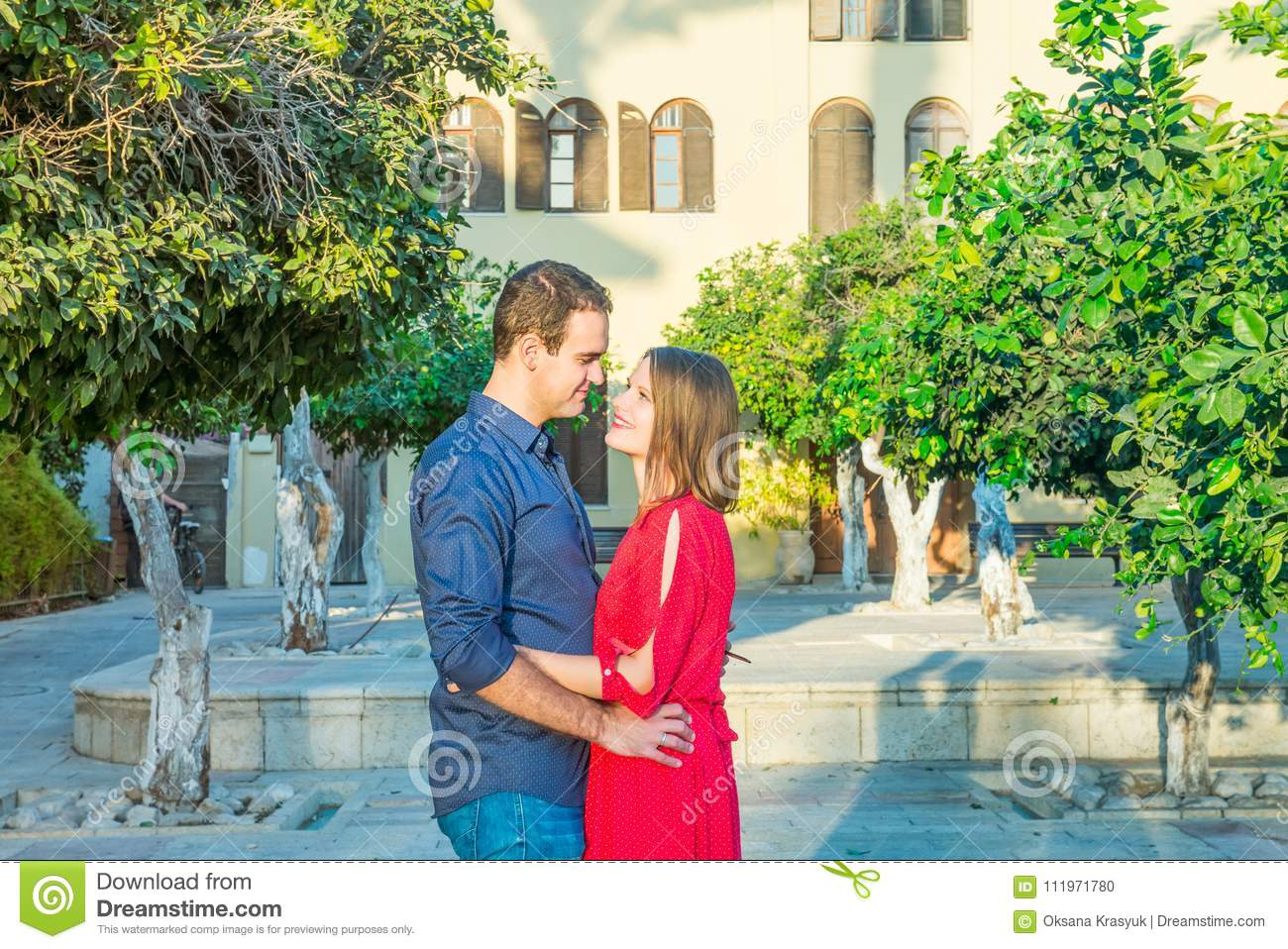 Romantic Young Couple In Bright Red And Blue Clothes Embracing On Street Romance The Mediterranean City