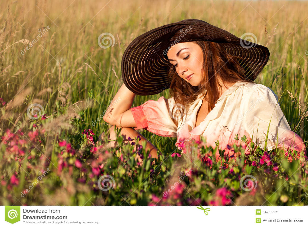 Romantic Young Woman In Hat Standing On Meadow In Hot Summer Day ... 2f0d289e3697