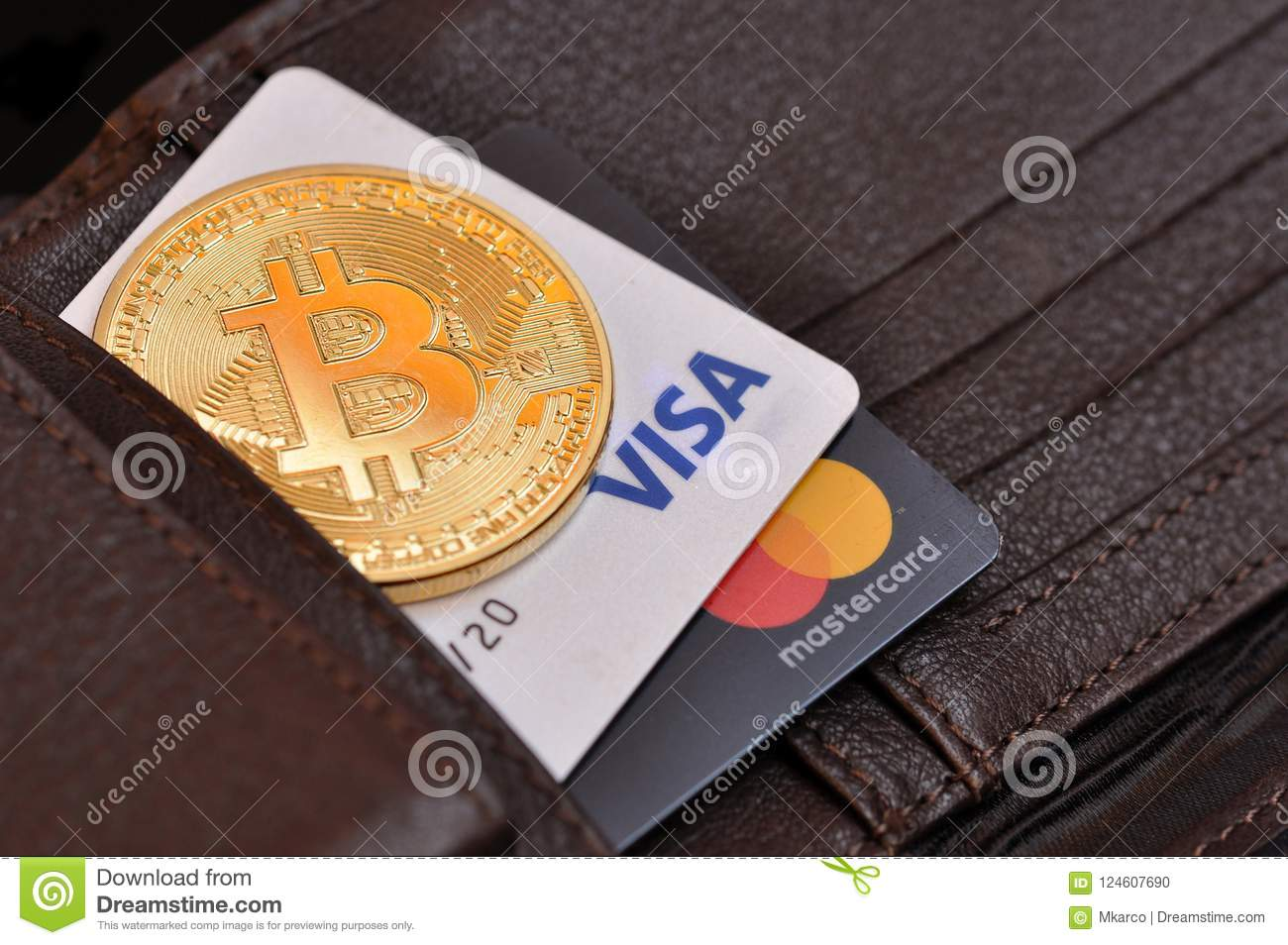 Rome, Italy, August 18, 2018. Bitcoin gold coin and debit cards