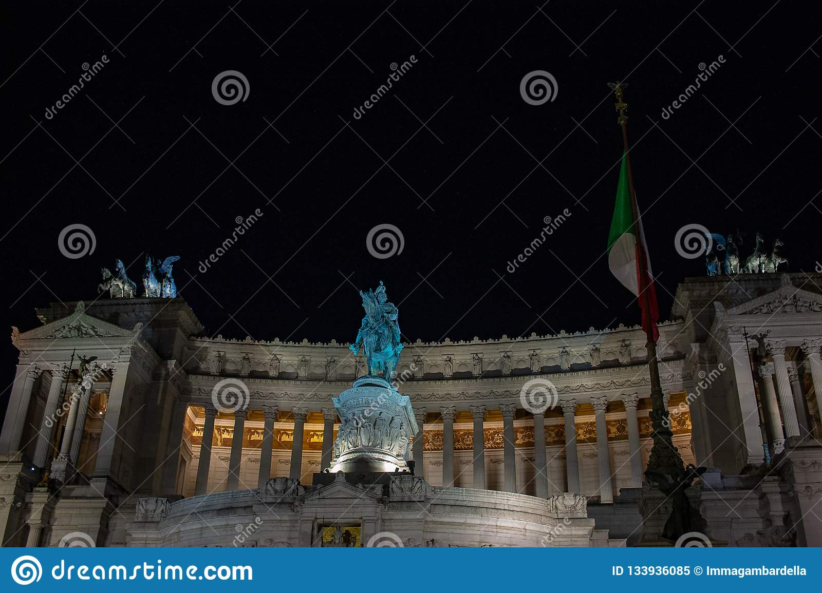 Lighting of the tree of Rome, in Piazza Venezia. Lights and red and yellow balls decorate the tree.