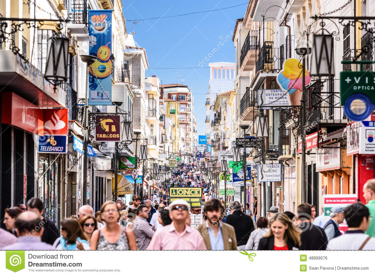 ... - OCTOBER 5, 2014: Crowds walk on Calle La Bola pedestrian street