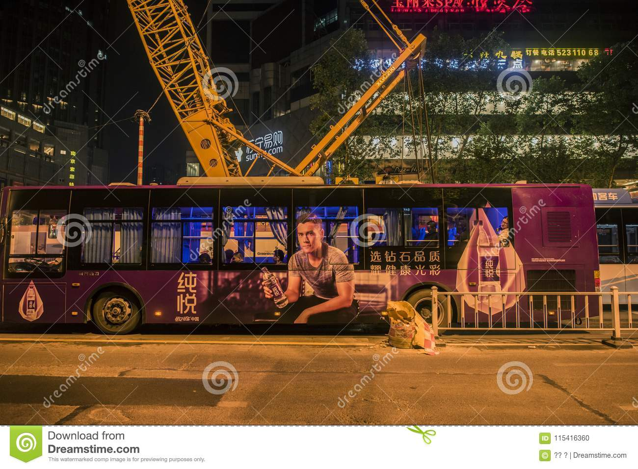 The roof of the bus seems to have a huge steel bus installed, the night view