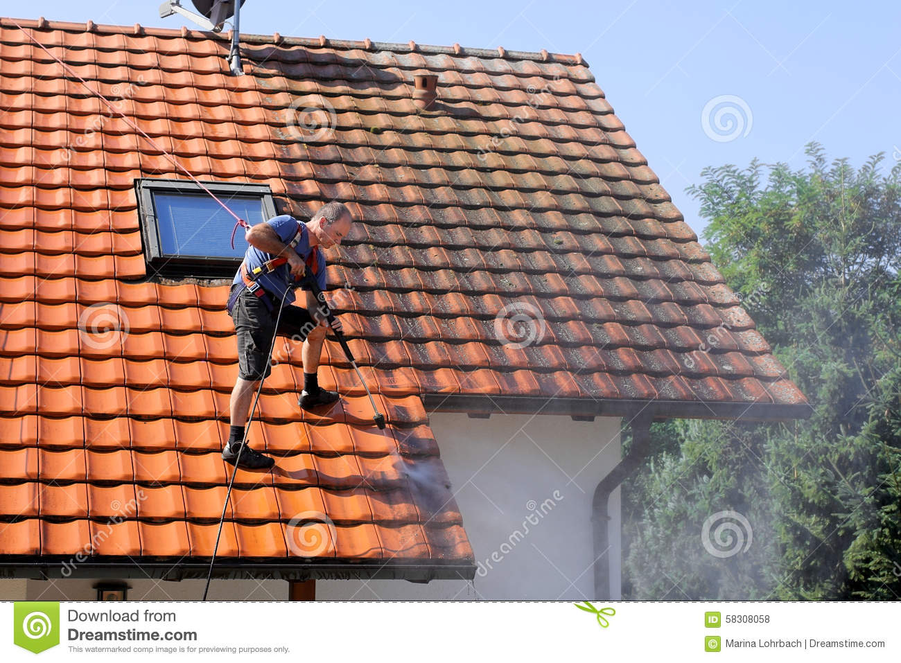 Roof cleaning with high pressure stock photo image 58308058 - Using water pressure roof cleaning ...