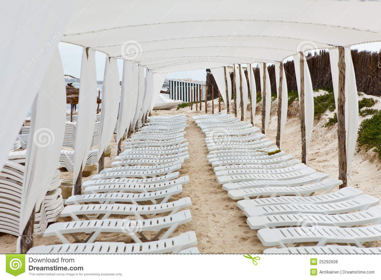 Roof covered place for chaise longues on beach stock photo for Beach chaise longue