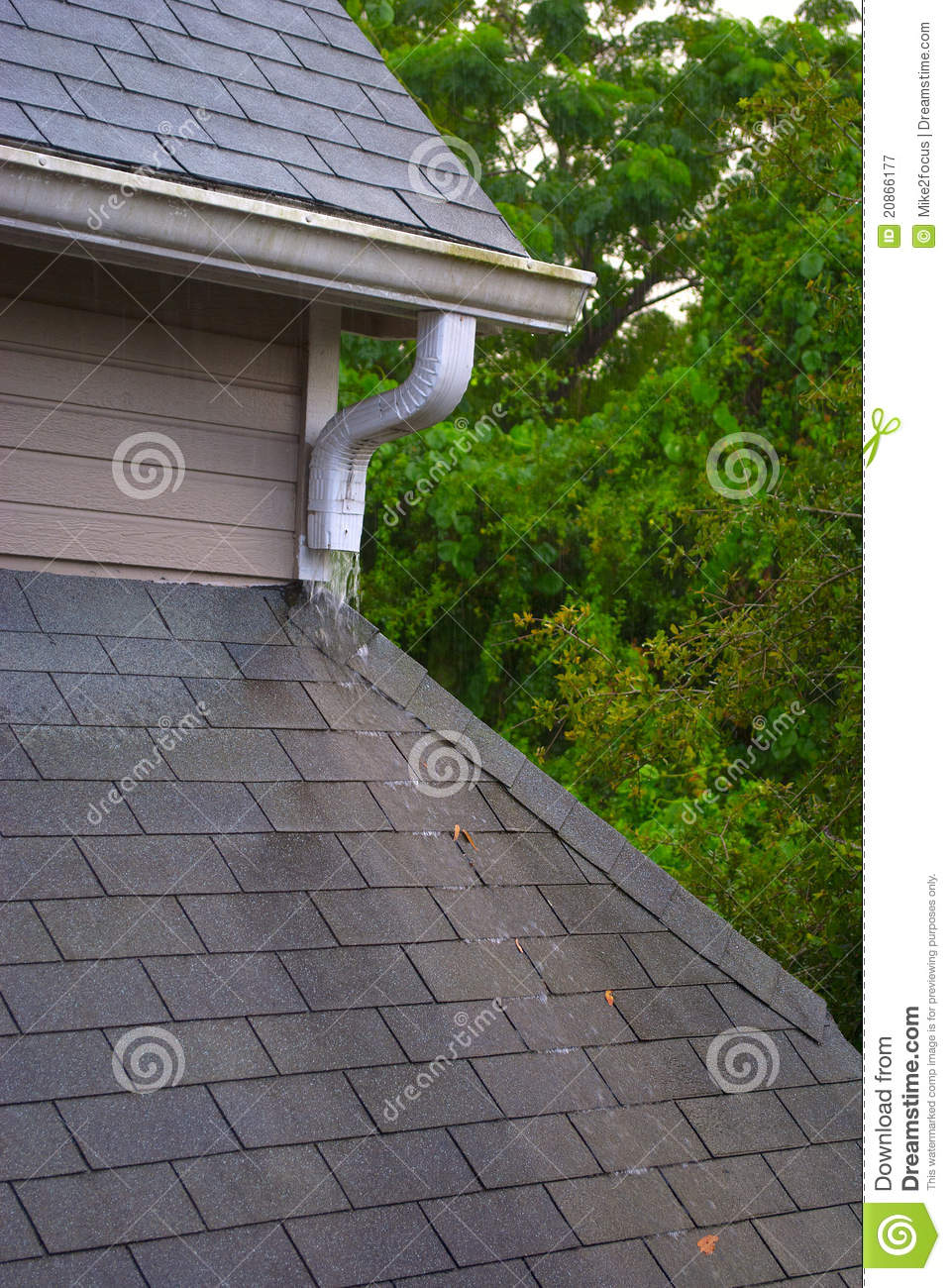 Roof Gutter And Shingles On A Rainy Day Stock Image
