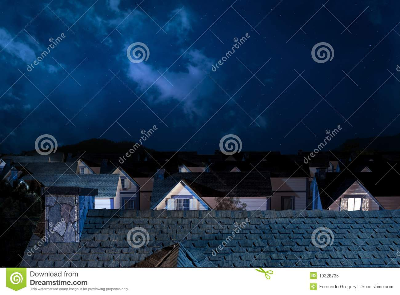 Roof Of House At Night With Houses On Background Stock
