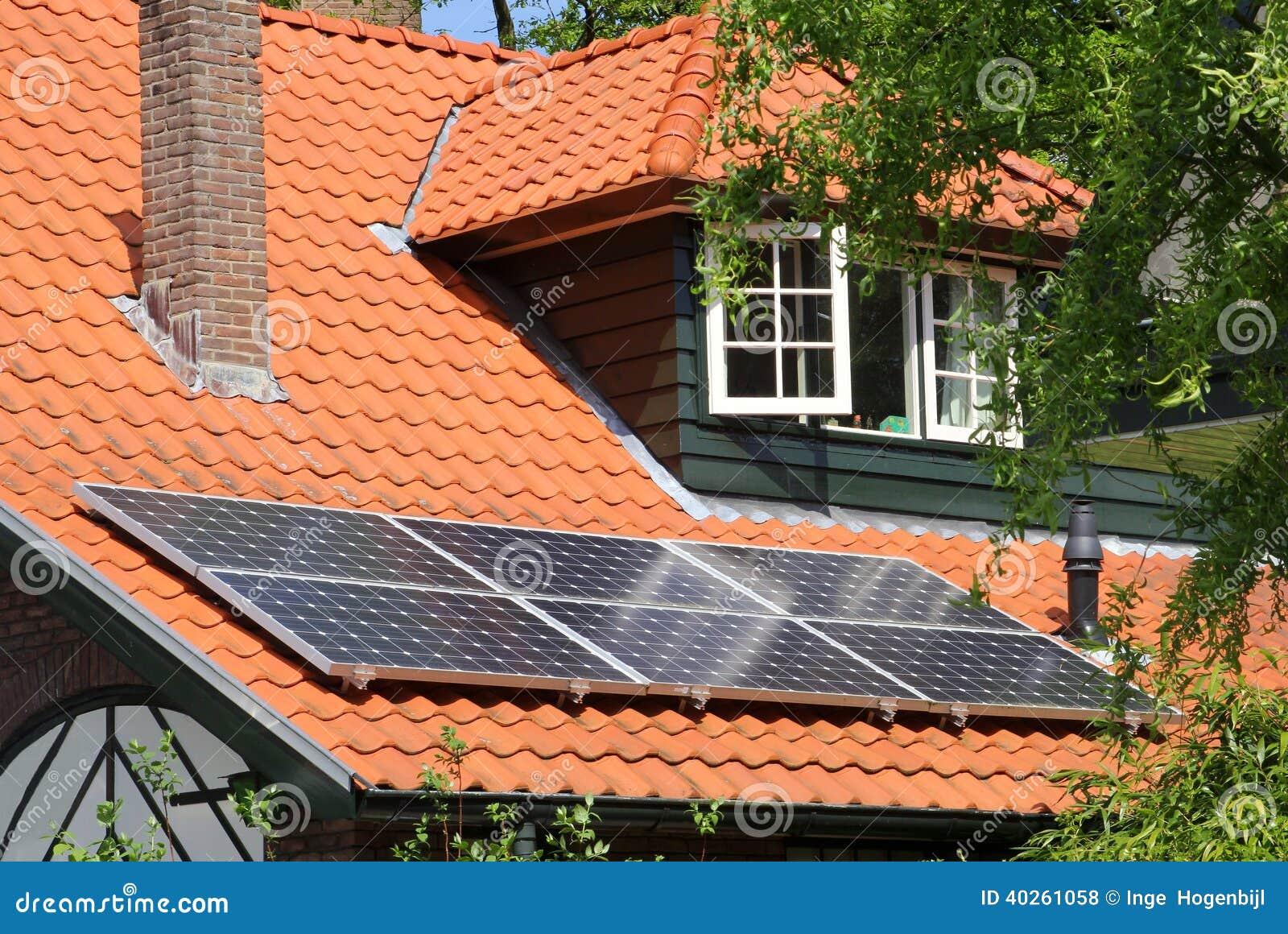 Modern Solar Panels On Scenic Red Tiled Roof Nl Stock