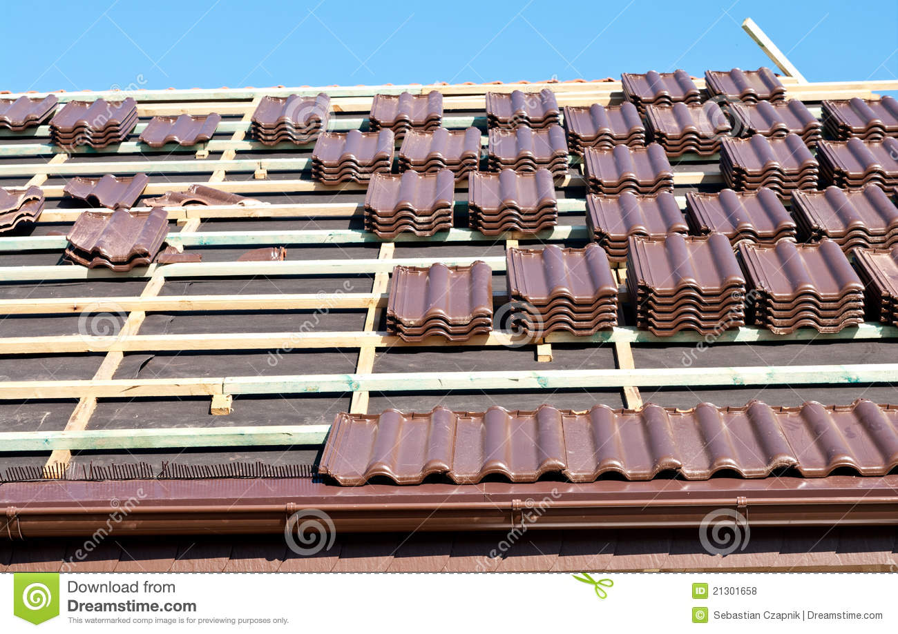 Roof tiles installation stock photo image of house ready 21301658 roof tiles installation dailygadgetfo Images