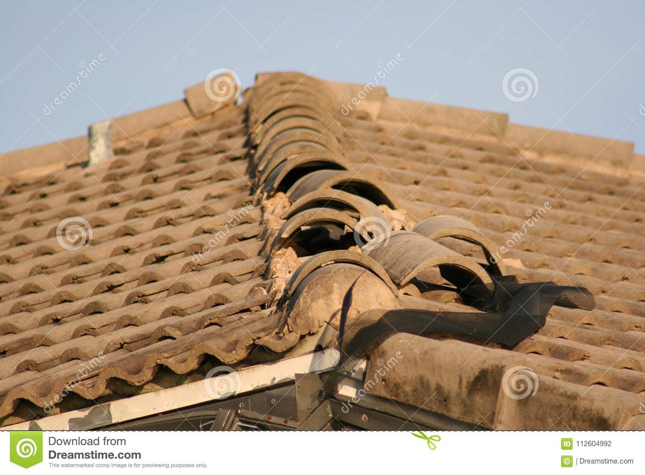 Roof tiles are ripped up from Hurricane winds.