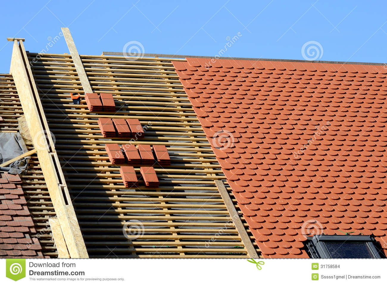 A Roof Under Construction With Stacks Of Roof Tiles Stock