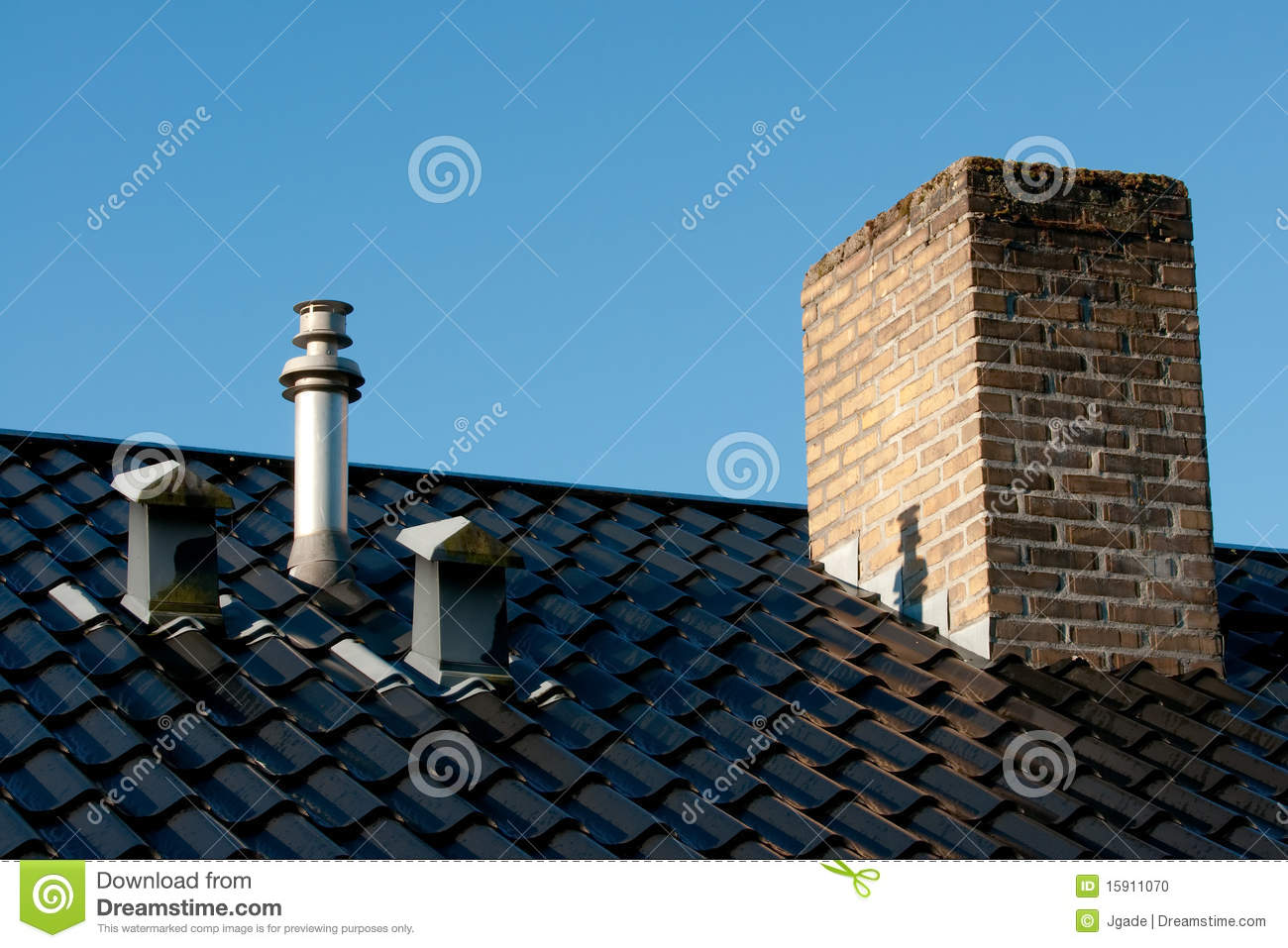 Roof With Ventilation Flue Terminal And Chimney Stock