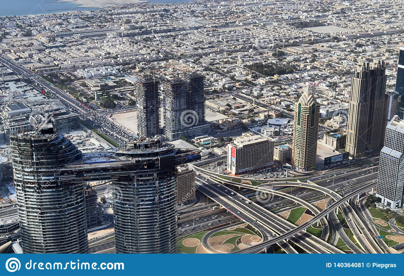 Roof View On Dubai From The 154th Floor Of The Burj Khalifa
