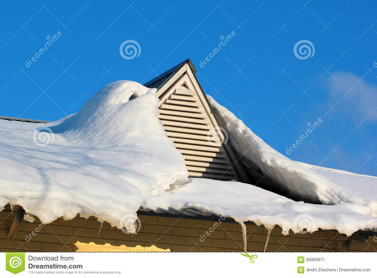 Roof window covered with snow