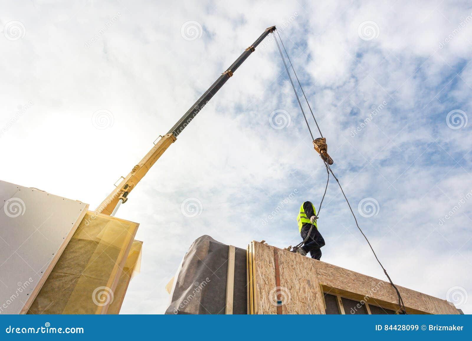 Roofer Builder Worker With Crane Installing Structural