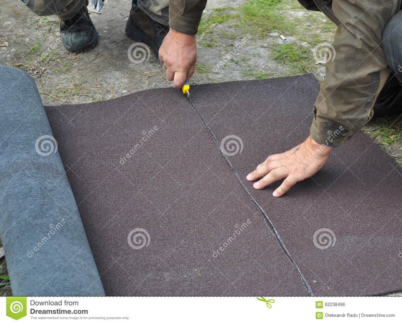 Roofer cutting roll roofing felt or bitumen during waterproofing works stock photo image 62238496 - Put bitumen shingles roof cover ...