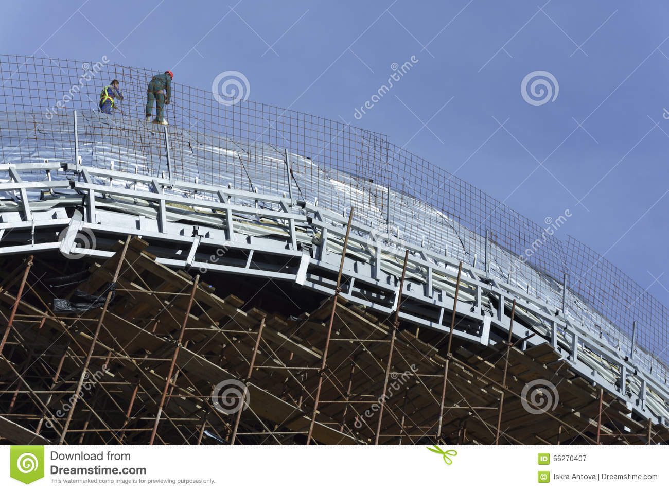 Roofers, tied with ropes working on the roof 4