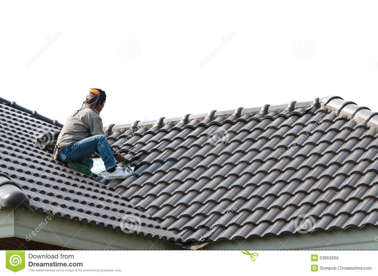 Roofing   Construction Worker Standing On A Roof Covering It Wit