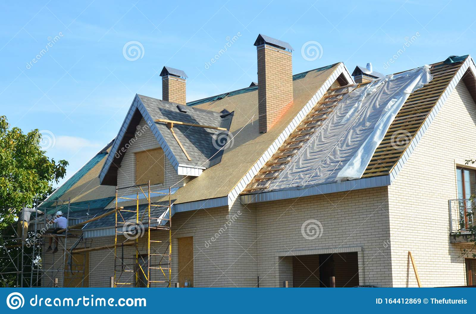 Roofing Contractors Installing House Roof Asphalt Shingles ...