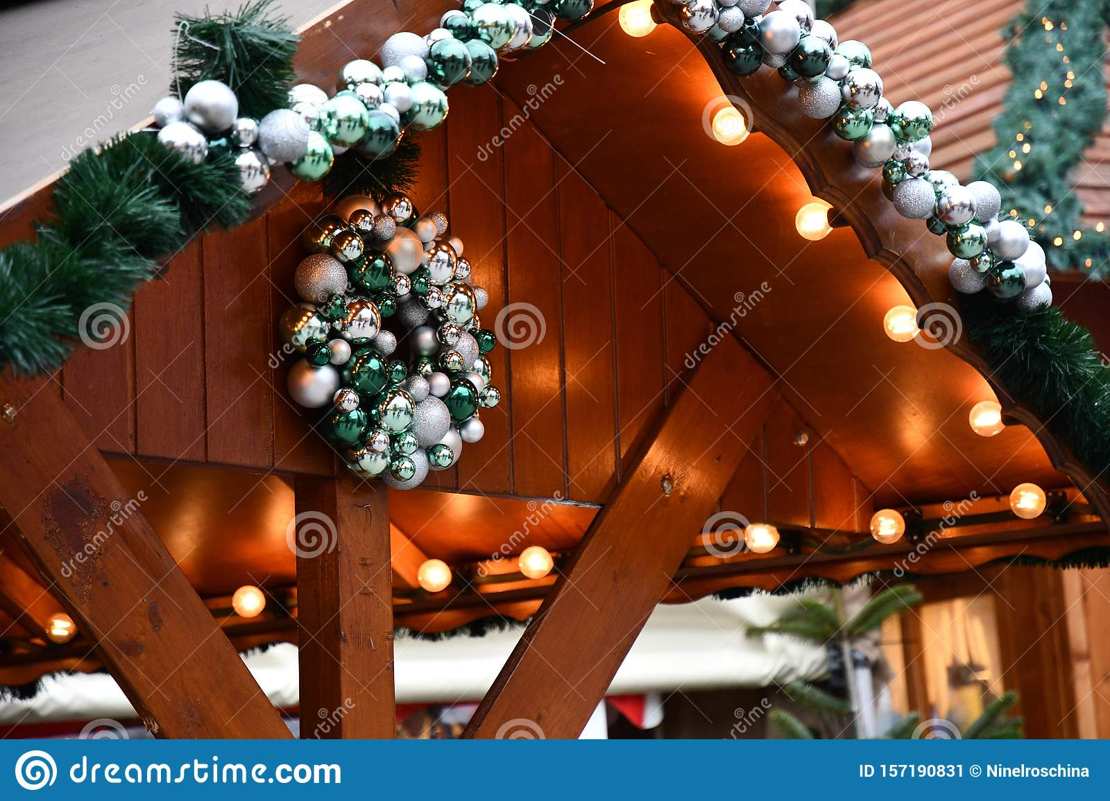 Christmas Ball Garlands.Rooftop Decorated With Silver Green Christmas Ball Garlands