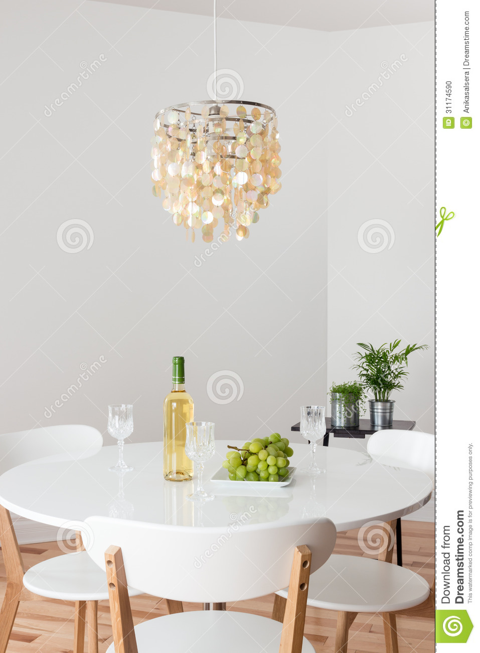 Room With Decorative Chandelier And White Round Table Stock Photo Image