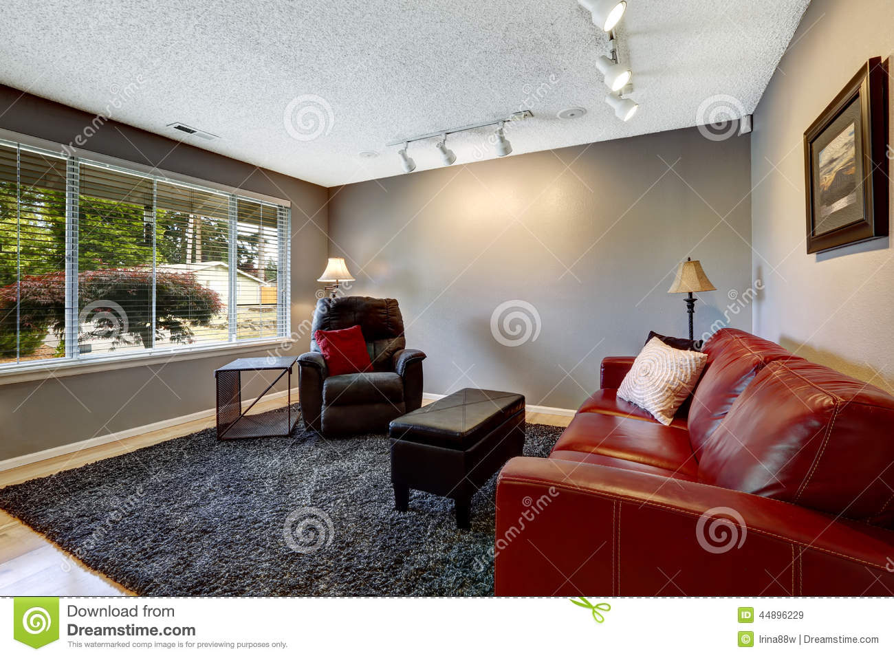 Room in grey color with bright red sofa stock image Red and grey sofa