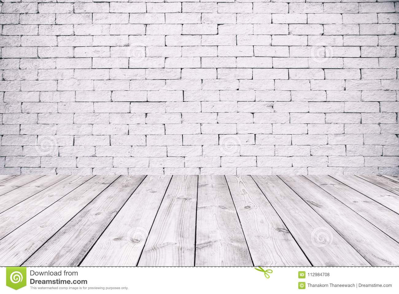Room interior with white brick wall and wooden floor