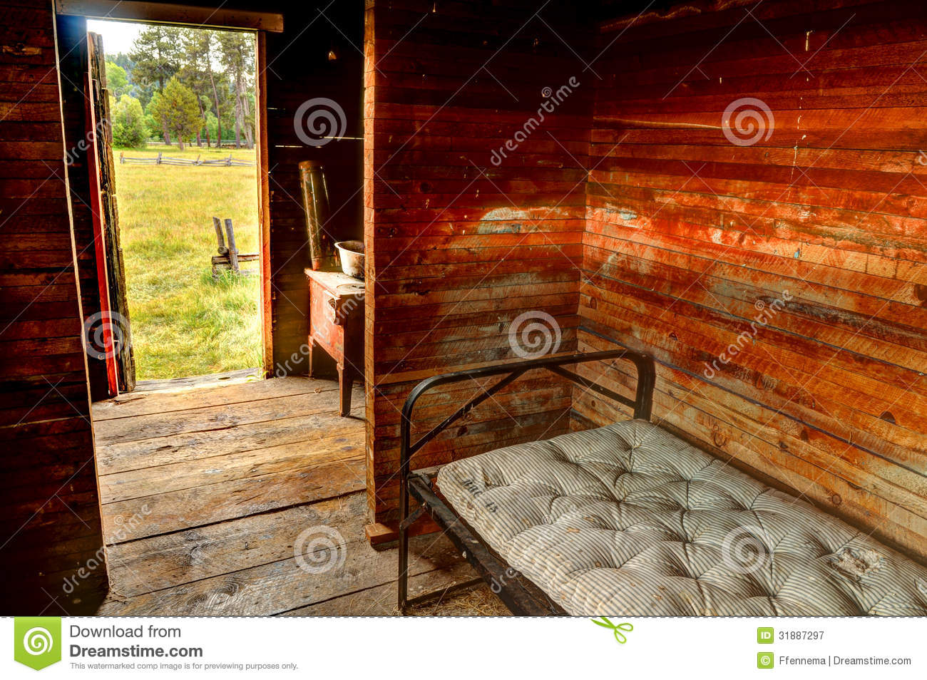 Room with a metal bed frame and old mattress stock image for Raw wood bed frame