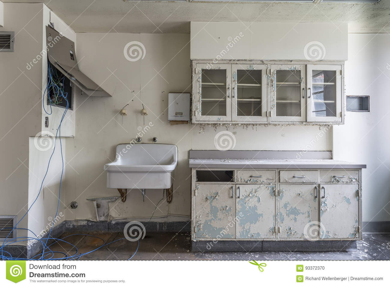 Room with sink in an abandoned hospital