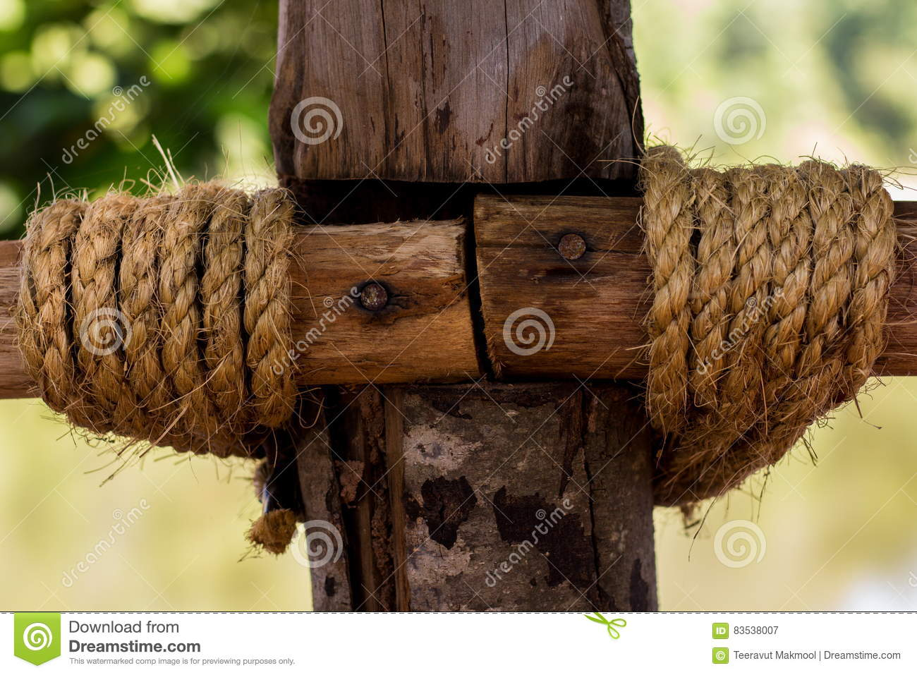 Bound to pole with rope out the