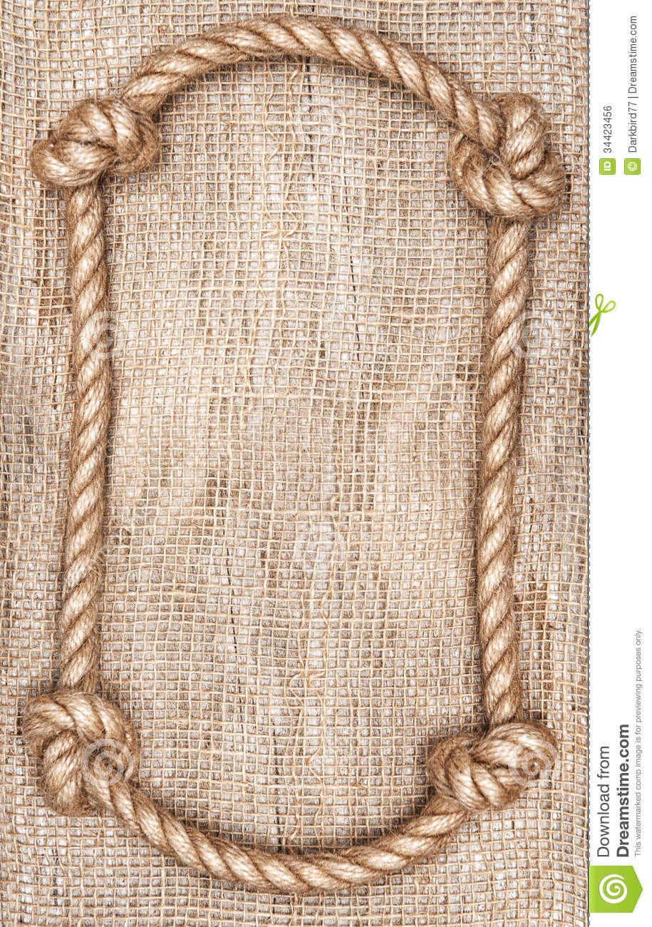 Rope frame and burlap background royalty free stock image Rope photo frame