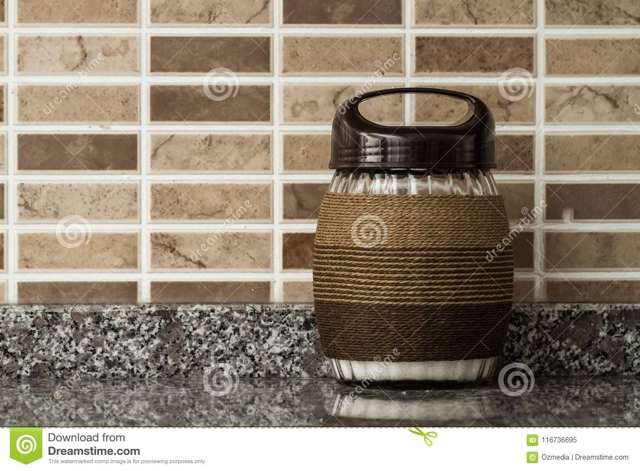 Rope Wrapped Decorative Glass Jars On Brown Background Stock Image