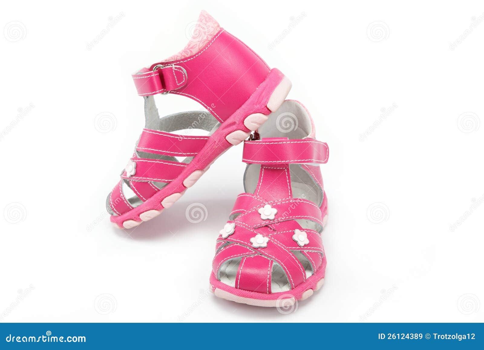 Rosa barns sandals som isoleras på white