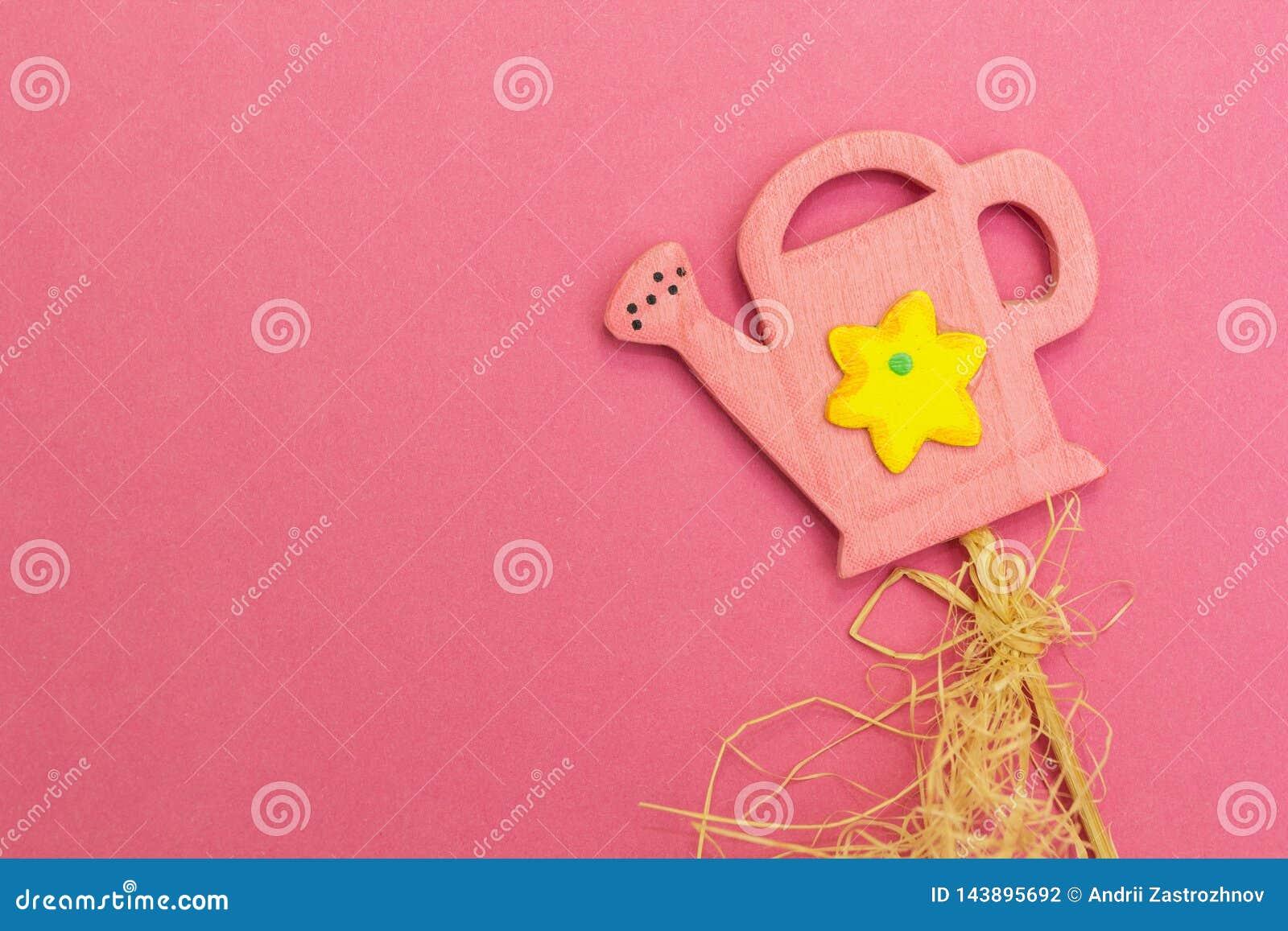 Rosa bevattna kan p? en rosa bakgrund, barns lekar