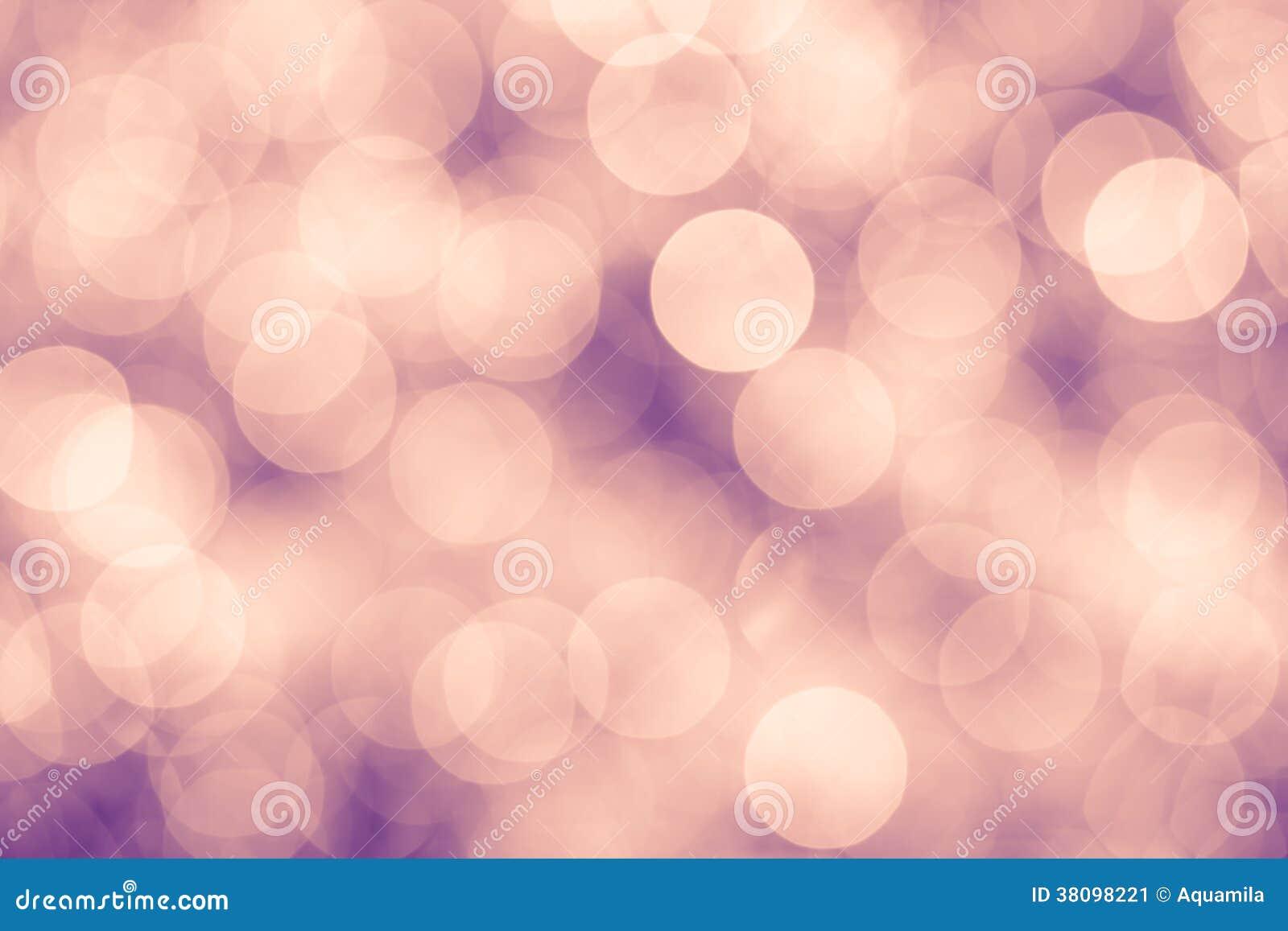Rosa und purpurroter Weinlesehintergrund mit bokeh defocused Lichtern