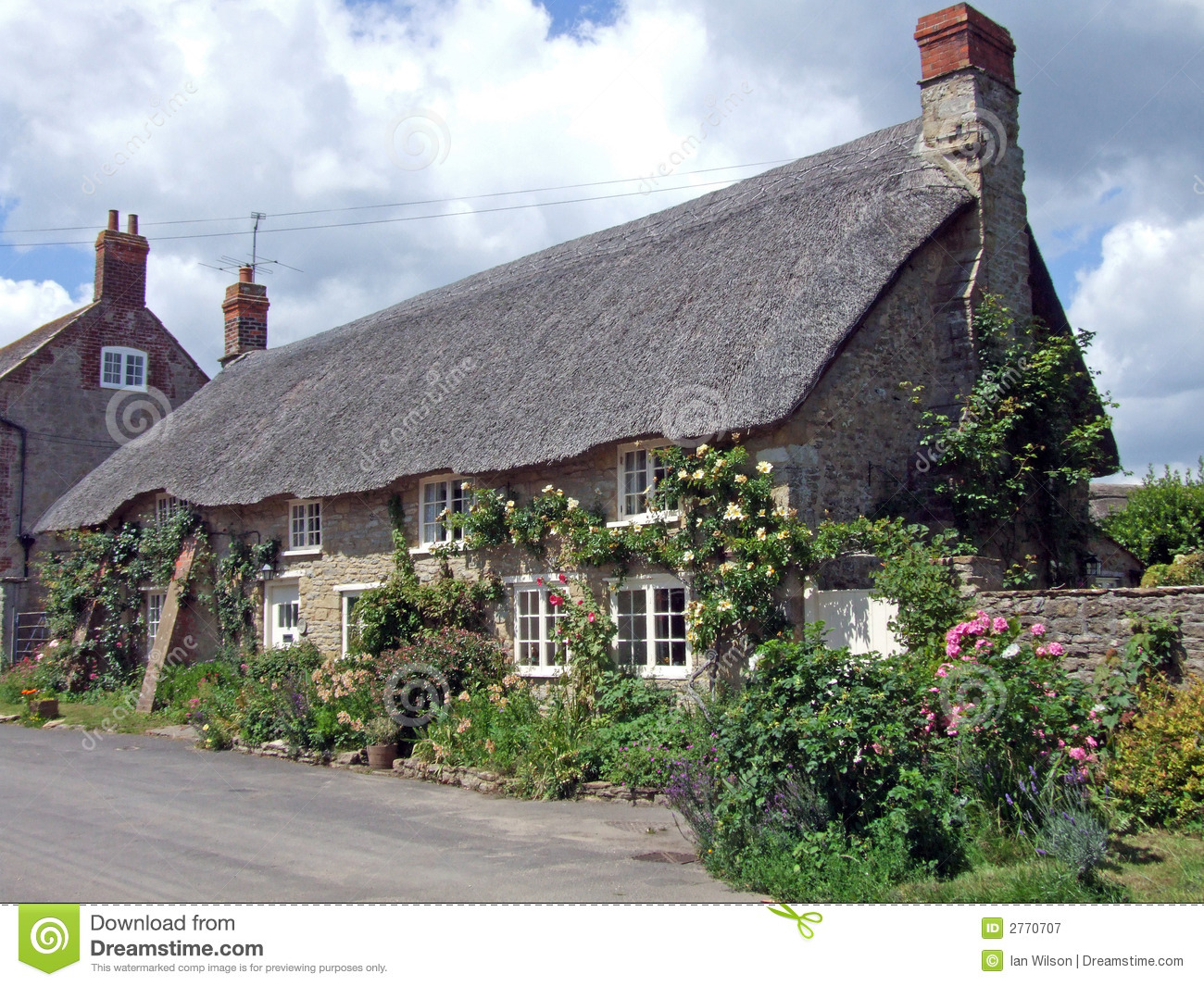 Rose Covered Thatched Cottage Royalty Free Stock