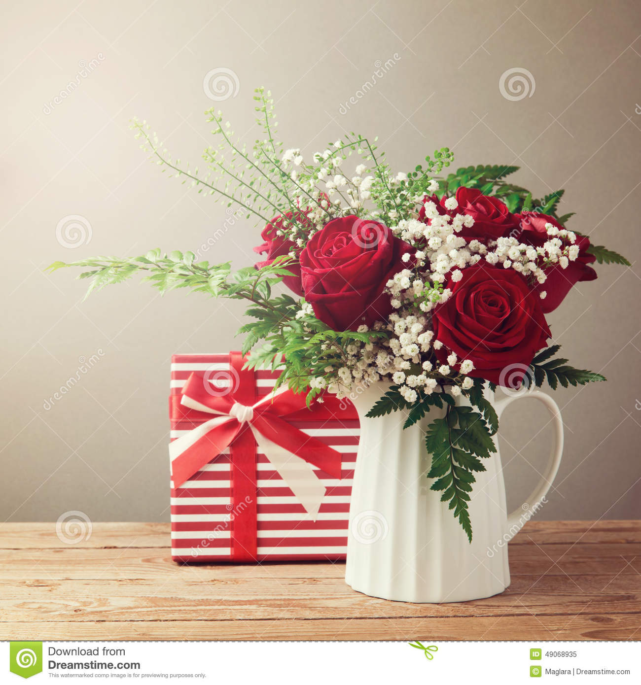 Rose Flower Bouquet And Gift Box On Wooden Table Stock