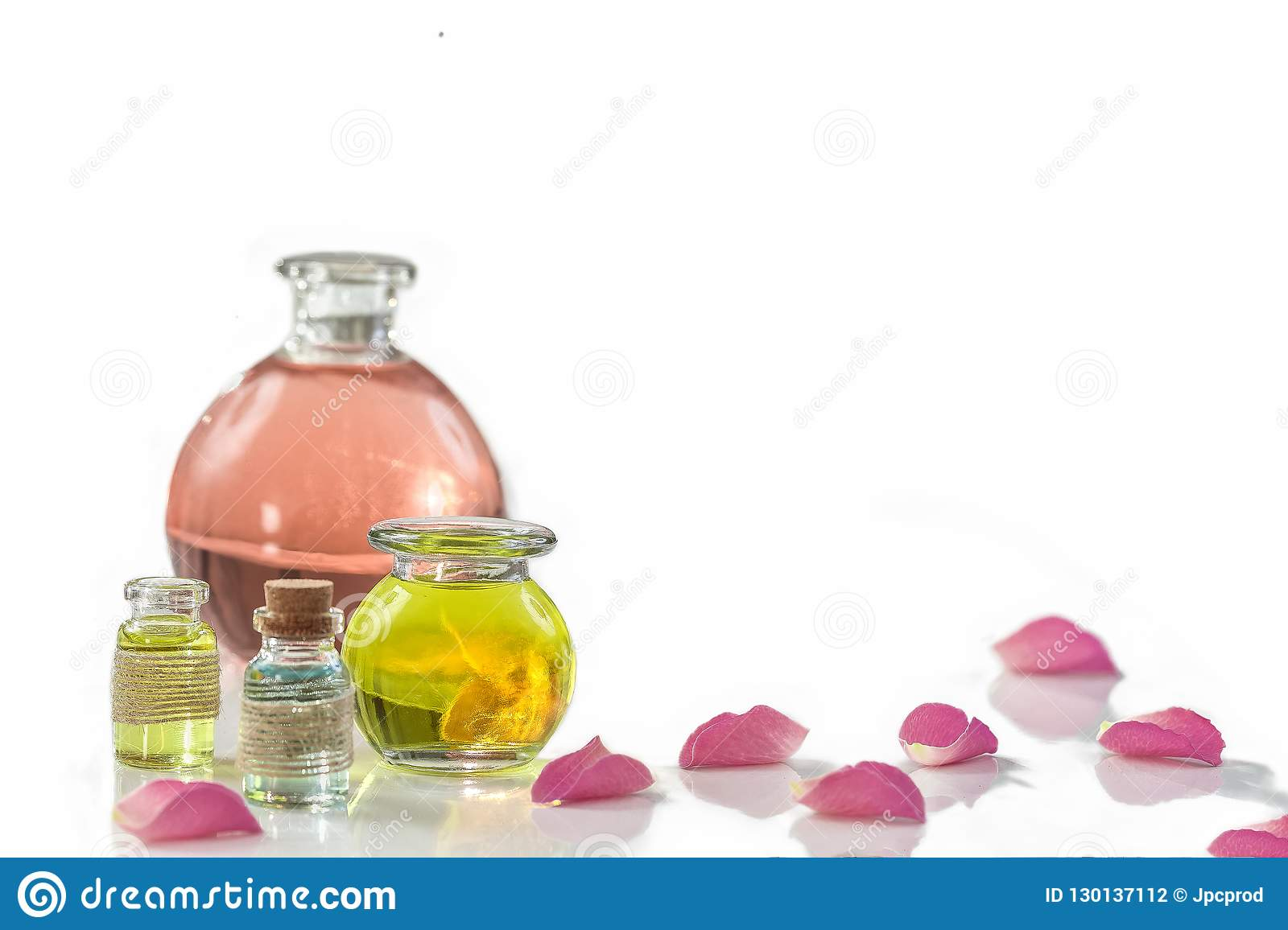 Rose Flower Petals With Aromatherapy Essential Oil Glass Bottle Over