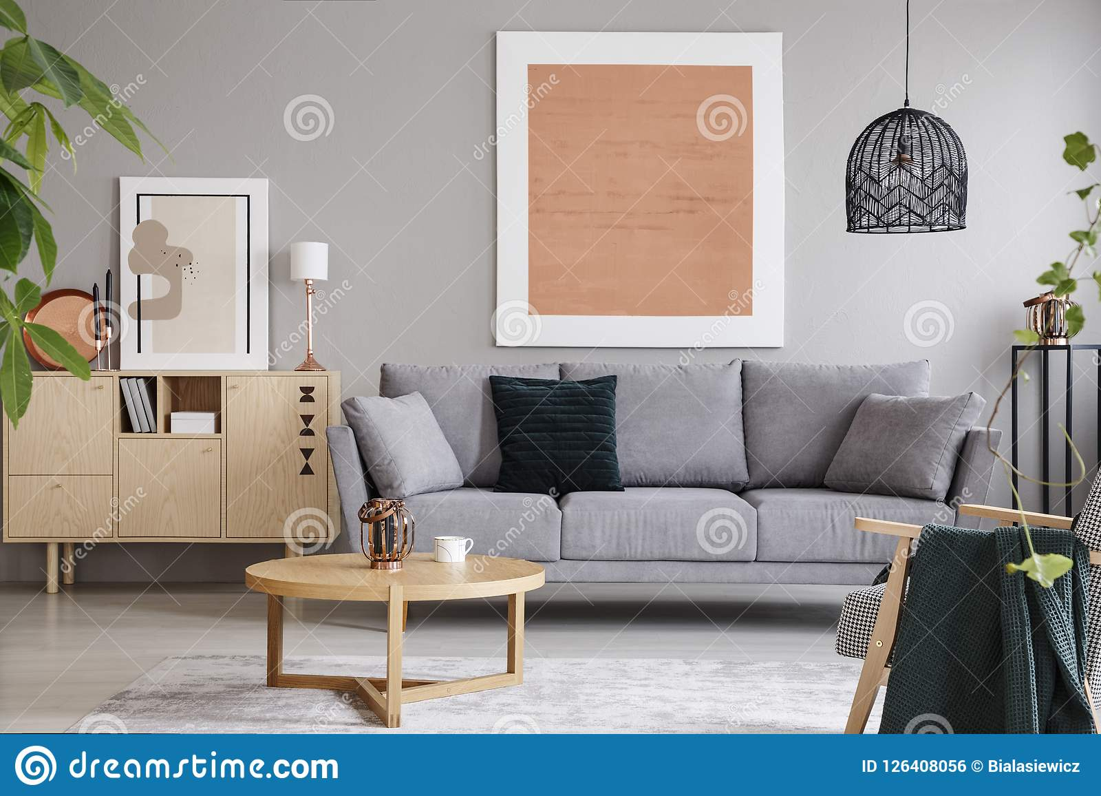Rose Gold Painting And Poster In Bright Loft Interior With